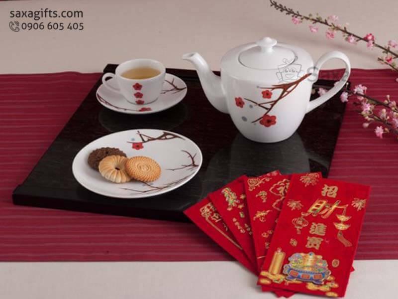 Bộ ấm trà gốm sứ Minh Long in hoa cành đào