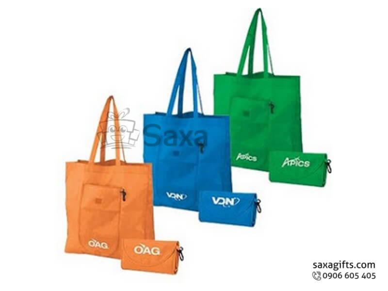 Túi môi trường in logo gấp gọn thành ví cầm tay có móc khóa