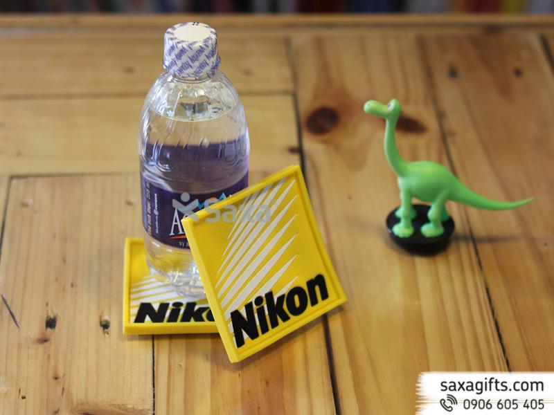 Lót ly cao su đổ khuôn logo Nikon (Rubber Coasters)
