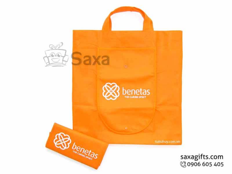 Túi môi trường in logo gấp thành ví cầm tay có nút bấm