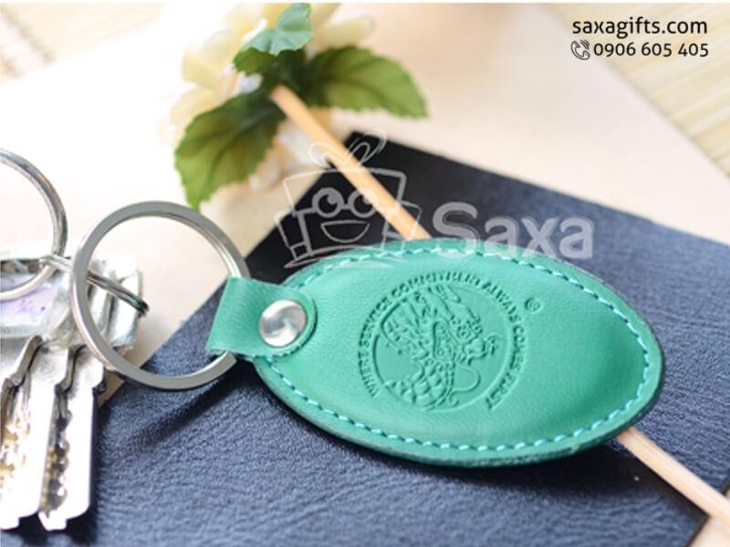 Móc khóa da in logo da màu xanh lá hình oval